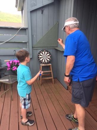 Life skills like darts with Pop Pop...