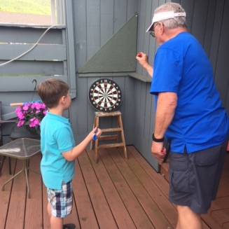 Life skills like darts with Pop Pop...