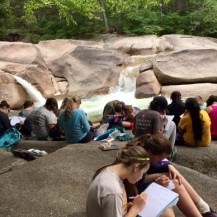 A bunch of us writing by waterfalls.